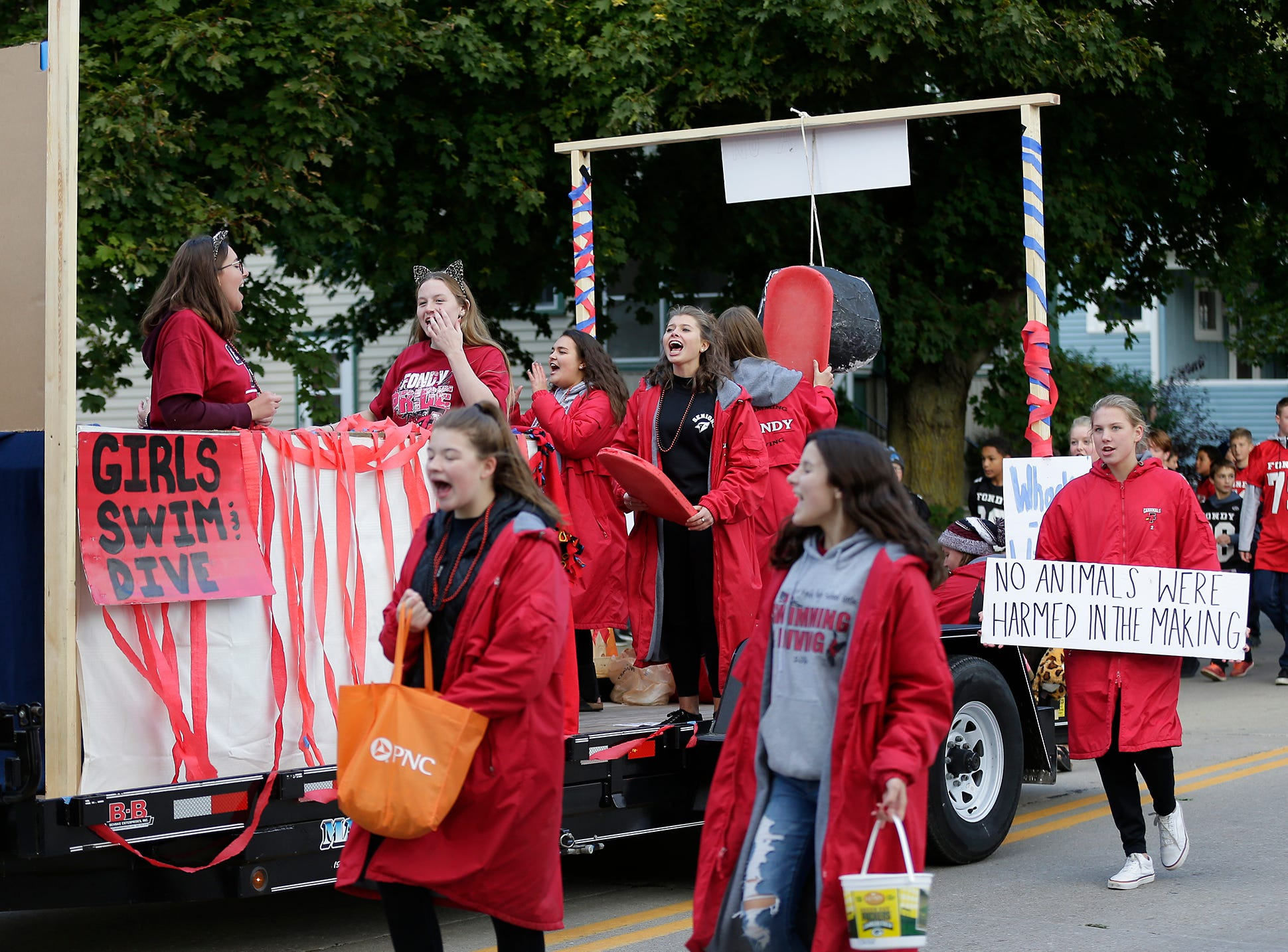 The Fond du Lac High School girls swim and dive team participated in the Fond du Lac High School football homecoming parade Friday, Sept. 28, 2018, which went down portions of Martin Avenue and Ninth Street in Fond du Lac, Wisconsin.
