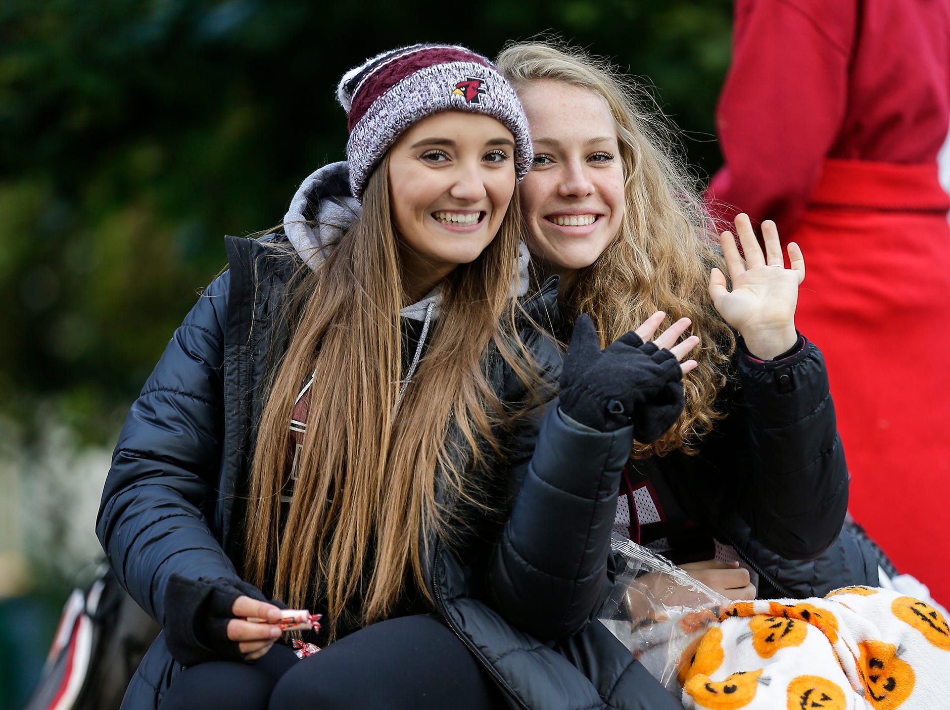 Fond du Lac High School girls golf members Jaydin Romalia and Talya Loken ride in the Fond du Lac High School football homecoming parade Friday, Sept. 28, 2018, which went down portions of Martin Avenue and Ninth Street in Fond du Lac, Wisconsin.