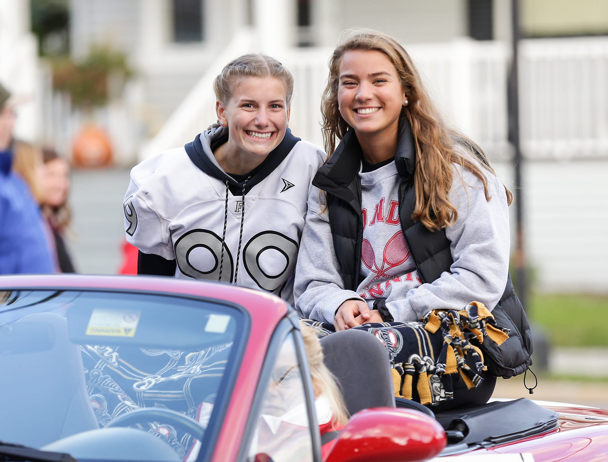 Fond du Lac High School seniors Emma Kottke and Anna Mauthe ride in the Fond du Lac High School football homecoming parade Friday, Sept. 28, 2018, which went down portions of Martin Avenue and Ninth Street in Fond du Lac, Wisconsin.