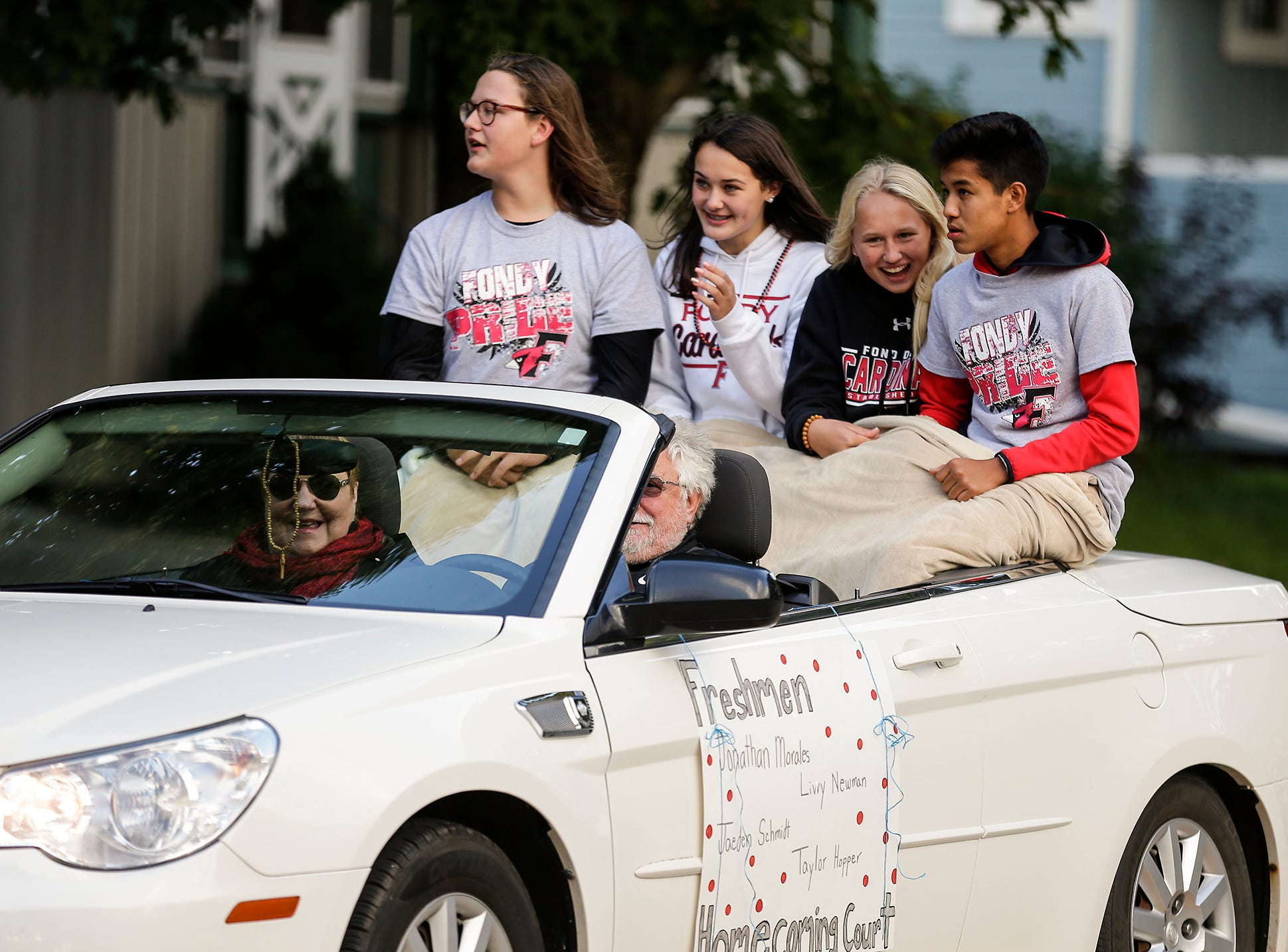 Fond du Lac High School freshman homecoming court members ride in the Fond du Lac High School football homecoming parade Friday, Sept. 28, 2018, which went down portions of Martin Avenue and Ninth Street in Fond du Lac, Wisconsin.