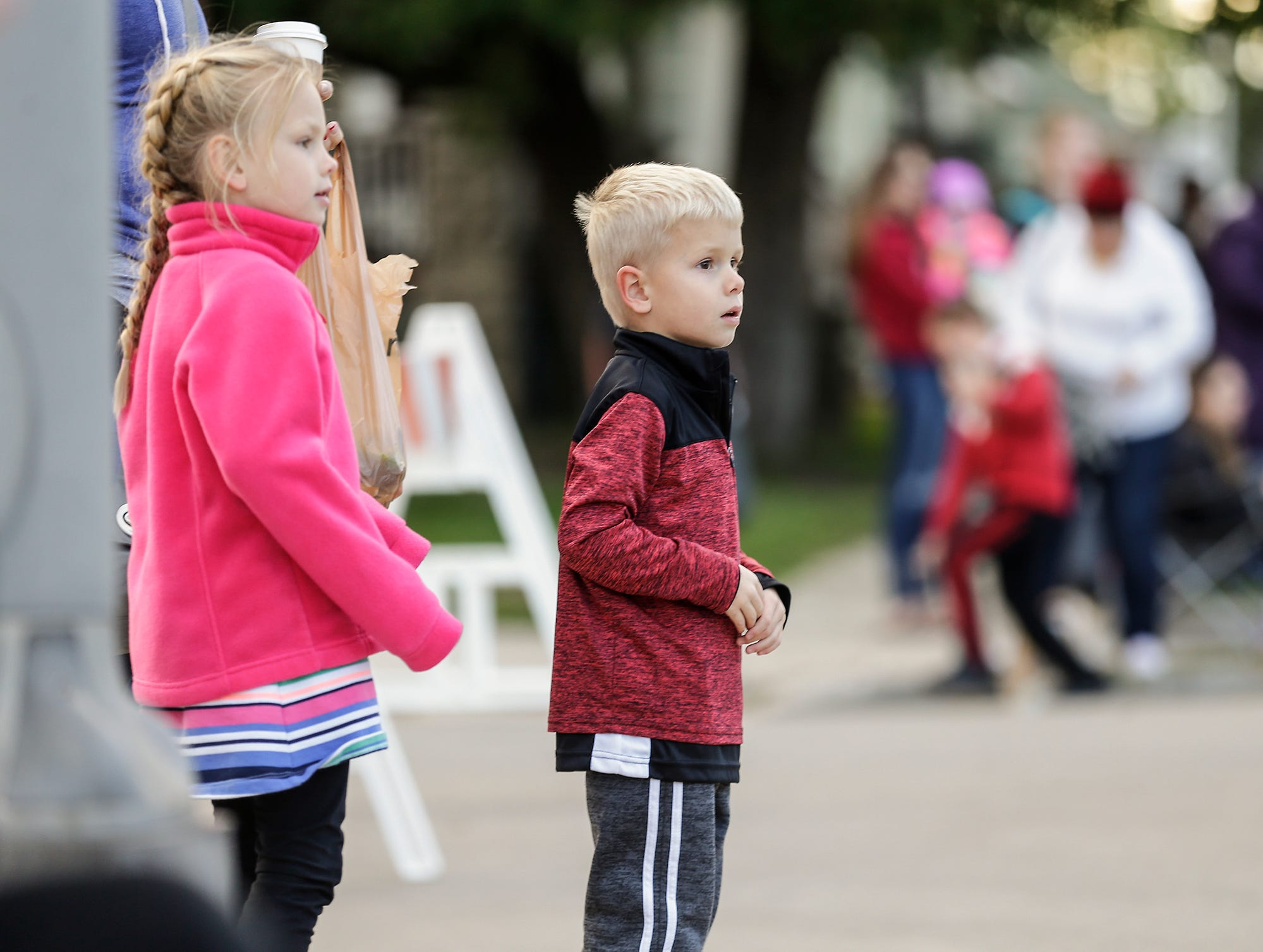 Natalie and Logan Regal of Fond du Lac watch the Fond du Lac High School football homecoming parade Friday, Sept. 28, 2018, which went down portions of Martin Avenue and Ninth Street in Fond du Lac, Wisconsin.