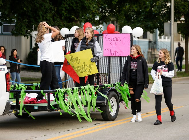 Fond do Lac girls volleyball players ride in the Fond du Lac High School football homecoming parade Friday, Sept. 28, 2018, which went down portions of Martin Avenue and Ninth Street in Fond du Lac, Wisconsin.