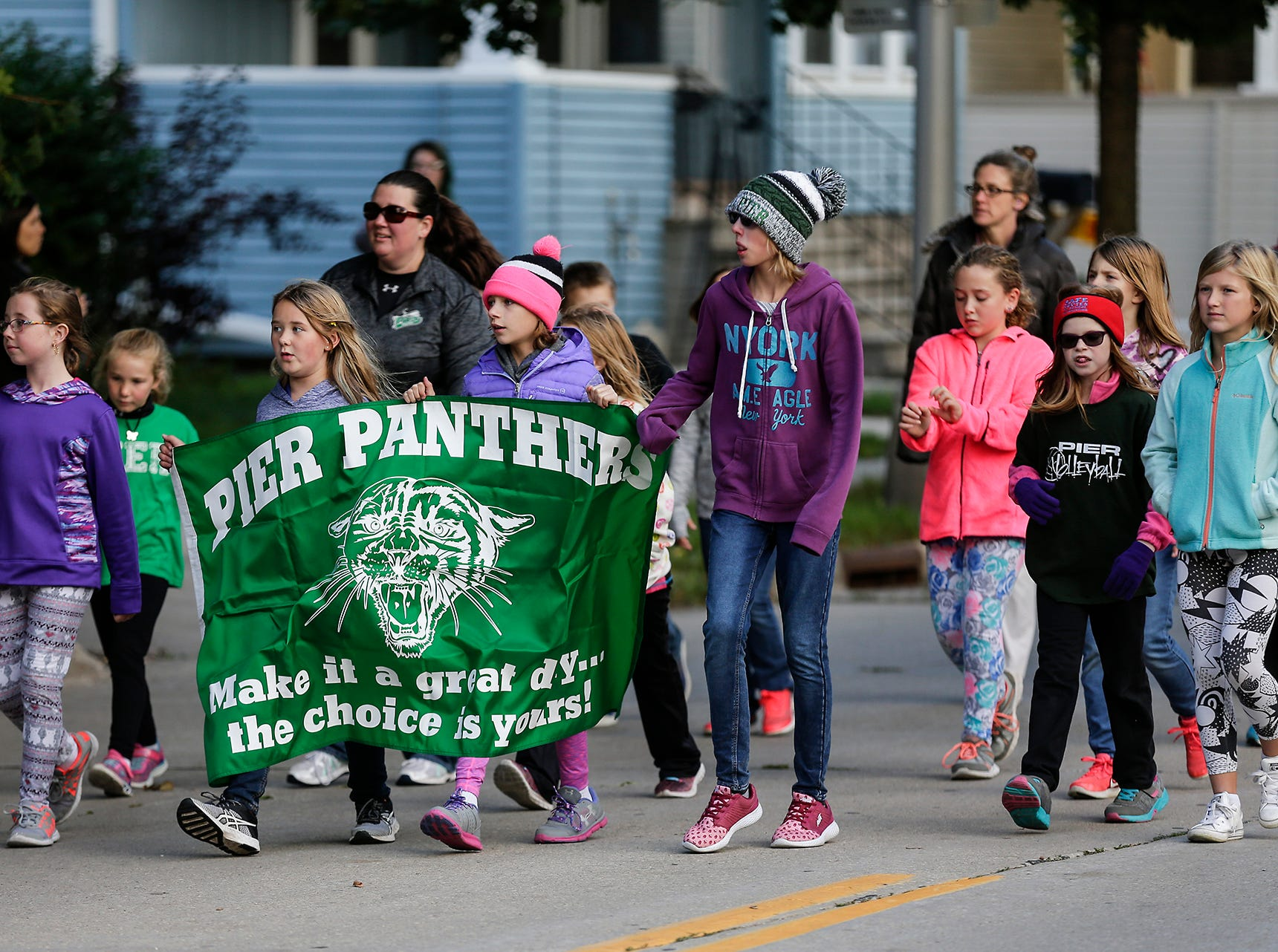 Students of Pier Elementary School marched in the Fond du Lac High School football homecoming parade Friday, Sept. 28, 2018, which went down portions of Martin Avenue and Ninth Street in Fond du Lac, Wisconsin.