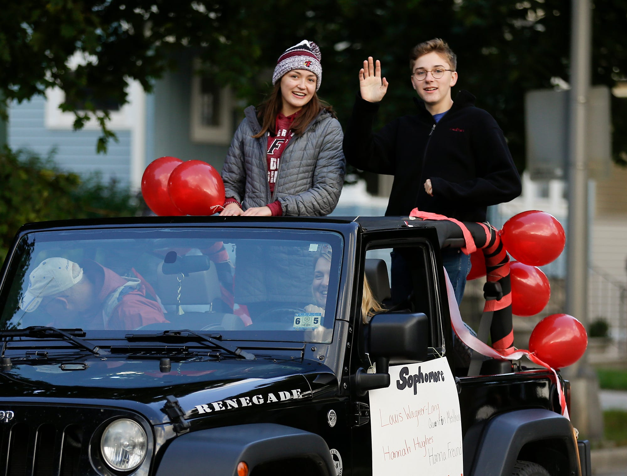 Fond du Lac High School sophomore prom court members Hanna Freund and Quentin Meilhon ride in the Fond du Lac High School football homecoming parade Friday, Sept. 28, 2018, which went down portions of Martin Avenue and Ninth Street in Fond du Lac, Wisconsin.