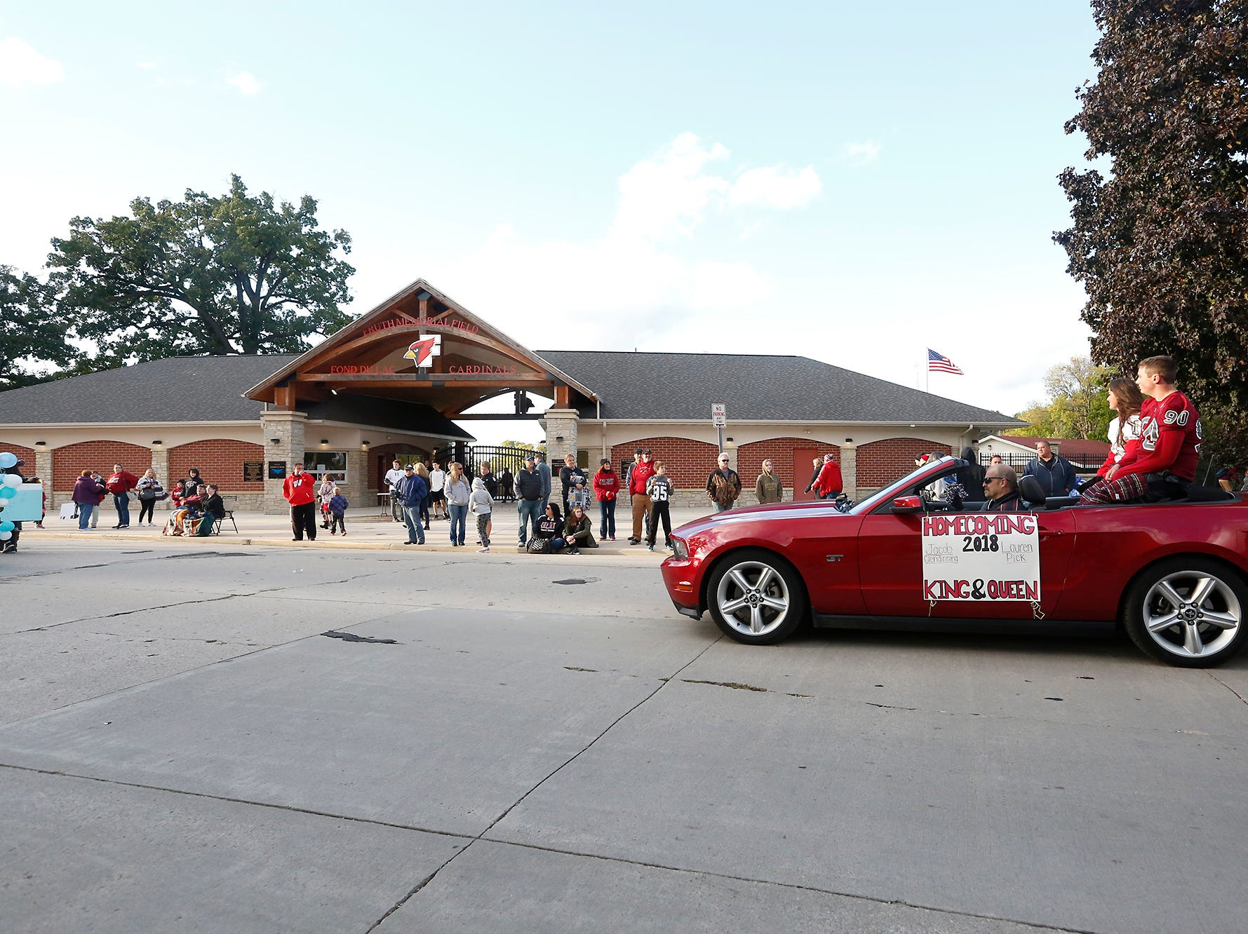 Fond du Lac High School homecoming king and queen Jacob Glendinning and Lauren Pick ride past Fruth Field during the football homecoming parade Friday, Sept. 28, 2018, which went down portions of Martin Avenue and Ninth Street in Fond du Lac, Wisconsin.