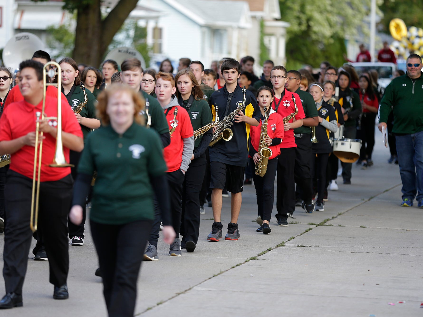 Members of Sabish Middle School, Theisen Middle School and Woodworth Middle School marching bands march in the Fond du Lac High School football homecoming parade Friday, Sept. 28, 2018, which went down portions of Martin Avenue and Ninth Street in Fond du Lac, Wisconsin.