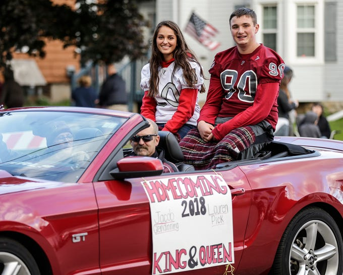 Fond du Lac High School homecoming king and queen Jacob Glendinning and Lauren Pick ride in the football homecoming parade Friday, Sept. 28, 2018, which went down portions of Martin Avenue and Ninth Street in Fond du Lac, Wisconsin.