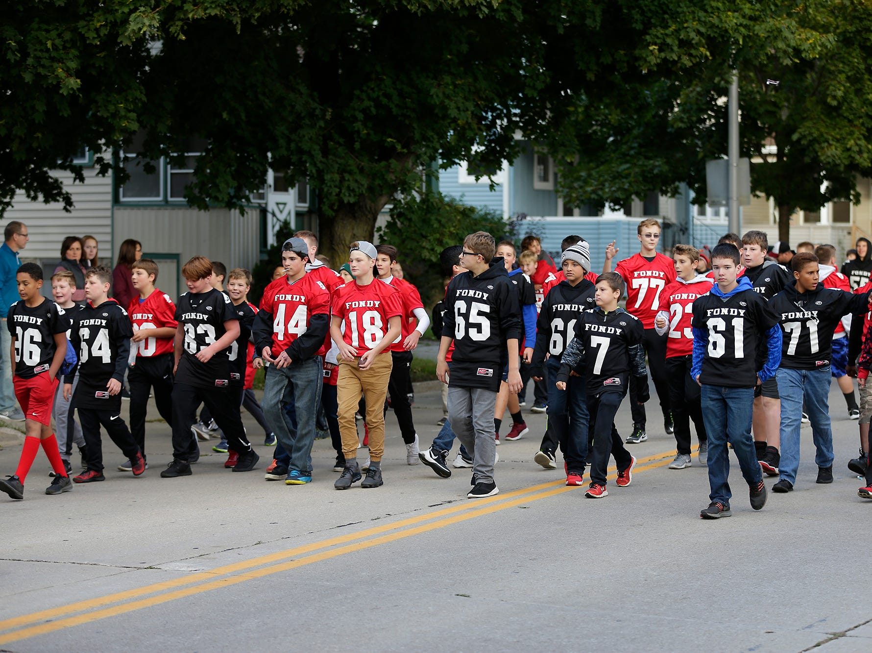 Fond du Lac grade school and middle school football players march in the Fond du Lac High School football homecoming parade Friday, Sept. 28, 2018, which went down portions of Martin Avenue and Ninth Street in Fond du Lac, Wisconsin.
