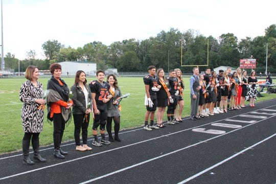 2018 Gibsonburg Homecoming Court along with former Queens