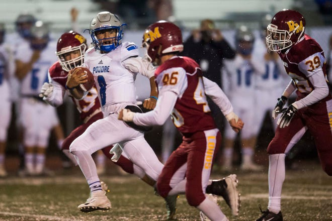 Poudre High School junior quarterback Sergio Tarango blows by Rocky Mountain defenders on his way to a 60-yard touchdown run during the Impalas' 45-14 rout of the Lobos on Friday night at French Field.