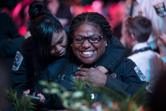 Officer of the Year nominee Emilia Lock, left, hugs Yvetta Dominique, the 2014 Officer of the Year at Saturday's Law and Order Ball at Germain Arena in Estero.