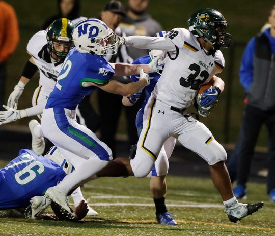 Green Bay Preble's E.J. Reese (32) rushes against Notre Dame on Friday night.