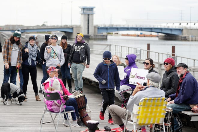 Protesters gathered Saturday at CityDeck in Green Bay to show support for sexual assault survivors in the wake of the Brett Kavanaugh hearing.