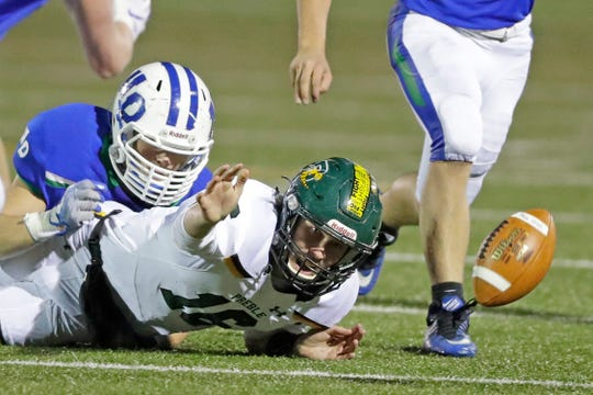 Green Bay Notre Dame's Mitch Chosa forces a fumble by Green Bay Preble quarterback Jack Dessart in the fourth quarter Friday at Notre Dame.