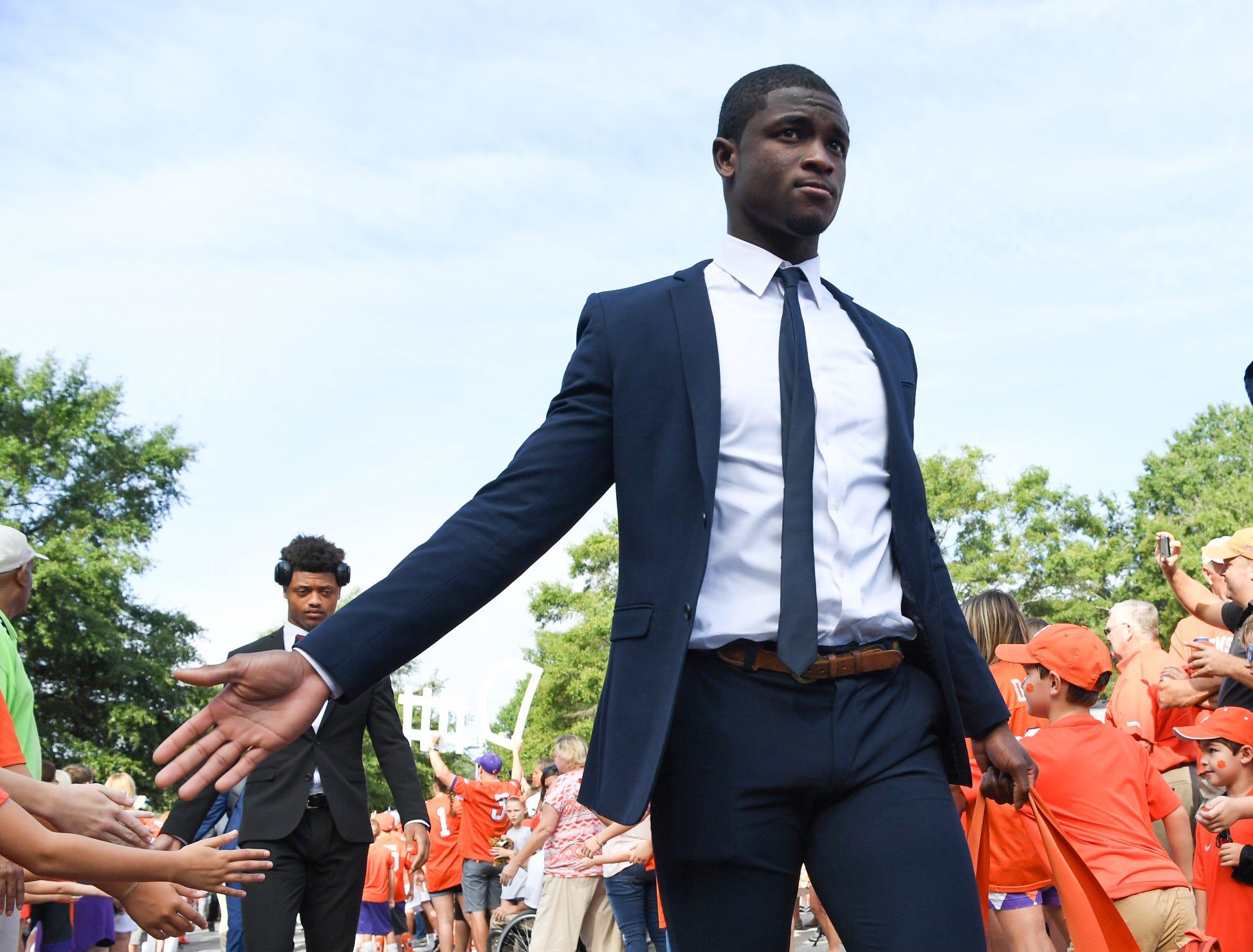 Clemson cornerback Trayvon Mullen (1) walks through fans toward Memorial Stadium during Tiger Walk in Clemson on Saturday, September 29, 2018.
