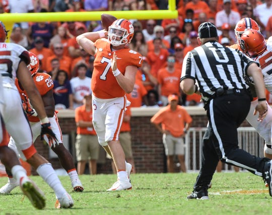 Clemson quarterback Chase Brice (7) passes to wide receiver Tee Higgins (5) for a first down late during the fourth quarter in Memorial Stadium on Saturday, September 29, 2018.
