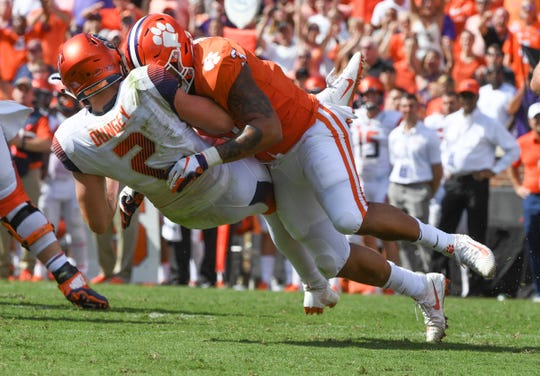 Clemson defensive lineman Xavier Thomas (3) sacks Syracuse quarterback Eric Dungey(2) during the fourth quarter in Memorial Stadium on Saturday, September 29, 2018.