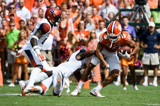 Clemson wide receiver T.J. Chase (18) is taken down by Syracuse defensive back Scoop Bradshaw(18) at Clemson's Memorial Stadium on Saturday, Sept. 29, 2018
