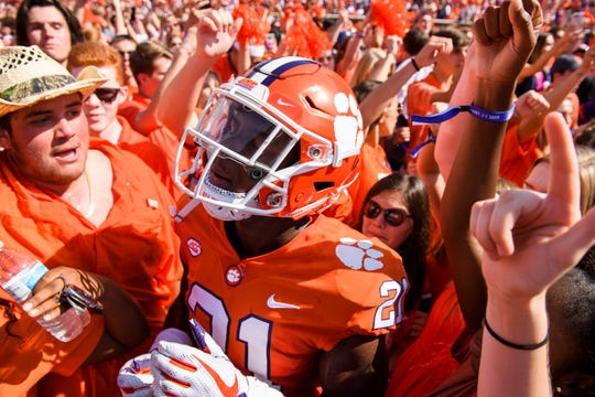 Clemson running back Darien Rencher (21) cheers with fans after their game against Syracuse at Clemson's Memorial Stadium on Saturday, Sept. 29, 2018