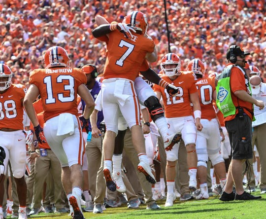 Clemson quarterback Chase Brice (7) celebrates the touchdown by running back Travis Etienne (9) during the fourth quarter in Memorial Stadium on Saturday, September 29, 2018.