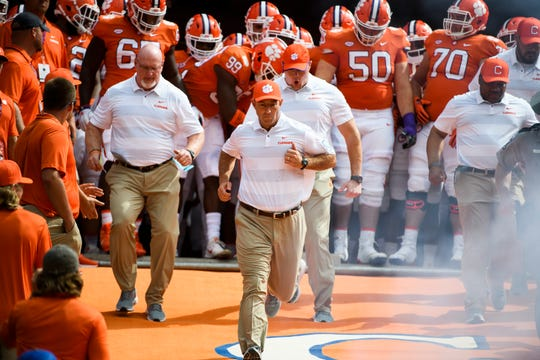Clemson Head Coach Dabo Swinney leads his team to the field before their game against Syracuse at Clemson's Memorial Stadium on Saturday, Sept. 29, 2018