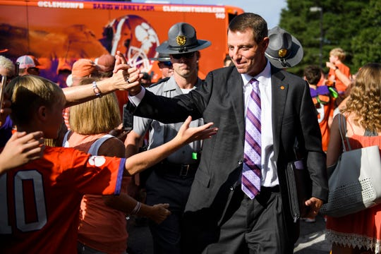Clemson Head Coach Dabo Swinney greets fans during the Tiger Walk at Clemson's Memorial Stadium before their game against Syracuse on Saturday, Sept. 29, 2018