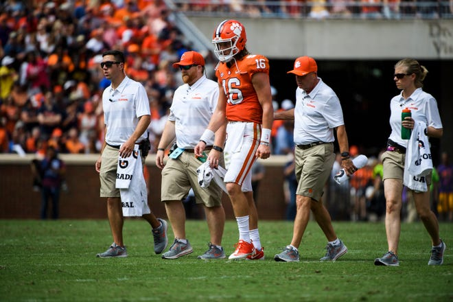 Clemson quarterback Trevor Lawrence (16) walks off the field after being injured during their game against Syracuse at Clemson's Memorial Stadium on Saturday, Sept. 29, 2018