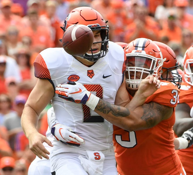 Clemson defensive lineman Xavier Thomas (3) hits Syracuse quarterback Eric Dungey(2) after pitching out the ball during the second quarter in Memorial Stadium on Saturday, September 29, 2018.