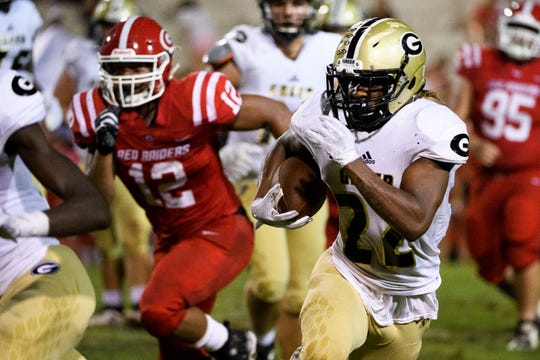 Greer's Dre Williams (22) advances with the ball during their game against Greenville at Sirrine Stadium on Friday, Sept. 28, 2018