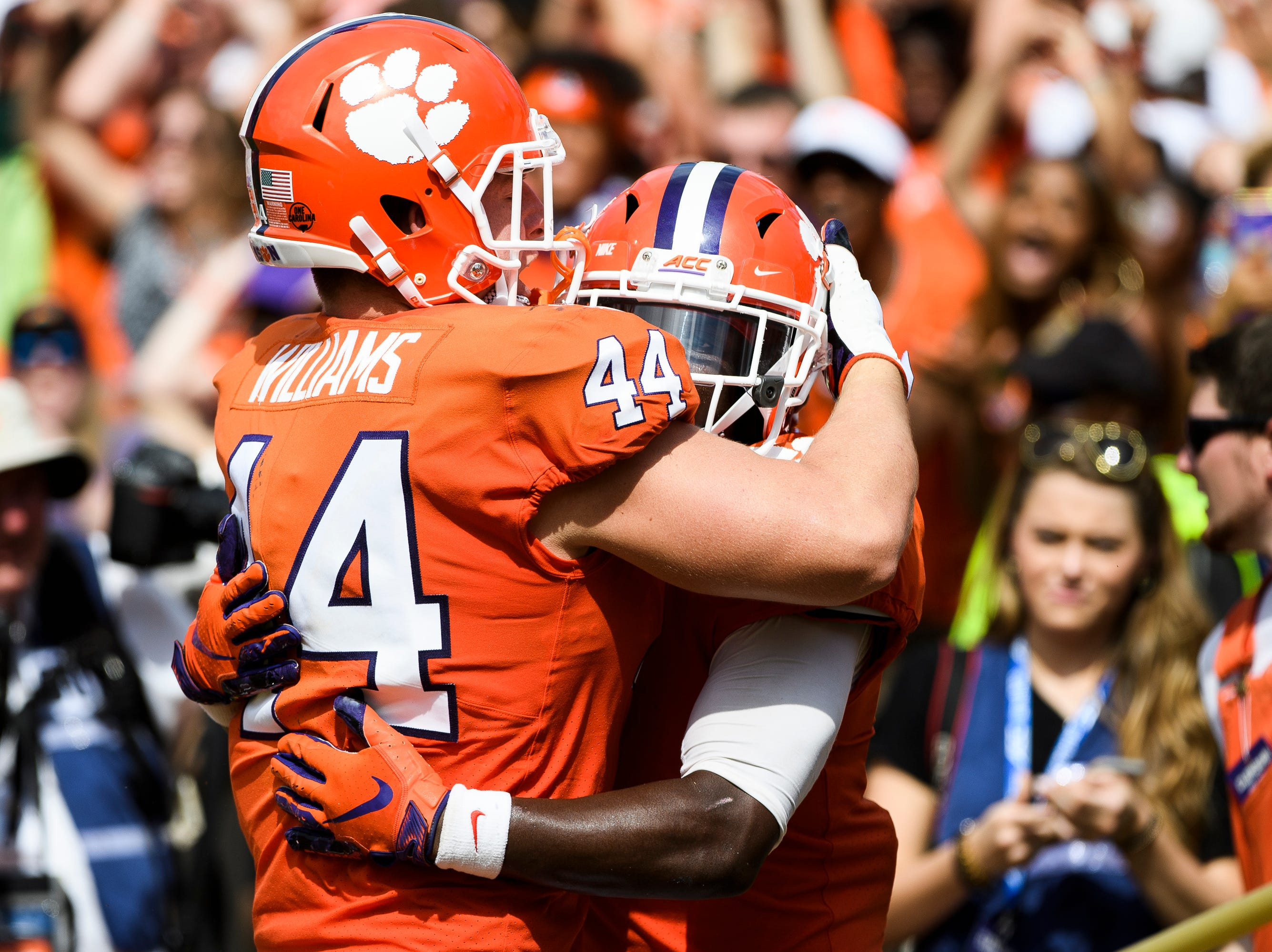 Clemson tight end Garrett Williams (44) hugs running back Travis Etienne (9) after he scored a touchdown against Syracuse at Clemson's Memorial Stadium on Saturday, Sept. 29, 2018
