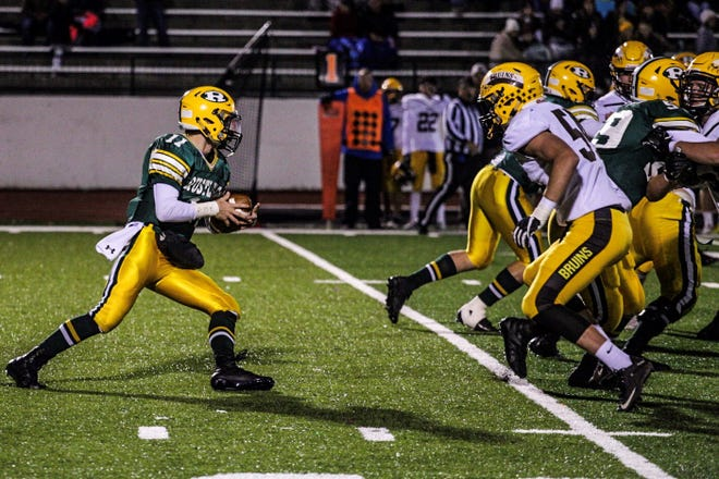 CMR quarterback Bryce Nelson looks for running room against Helena Capital in a game last season.