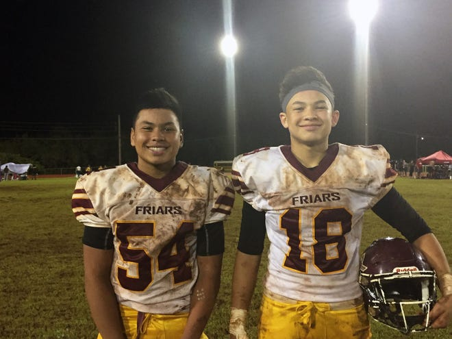 No. 54 Roy Chargualaf and No. 18 Evan Brown are starting middle linebackers for the Father Duenas Friars defense. Both are 15-year-old freshmen, and both combined for 17 tackles, a sack and forced fumble in a 39-0 win over the Southern High Dolphins Sept. 29 at the George Washington field in Mangilao. Kein Artero scored two TDs and ran for 149 yards in the win.