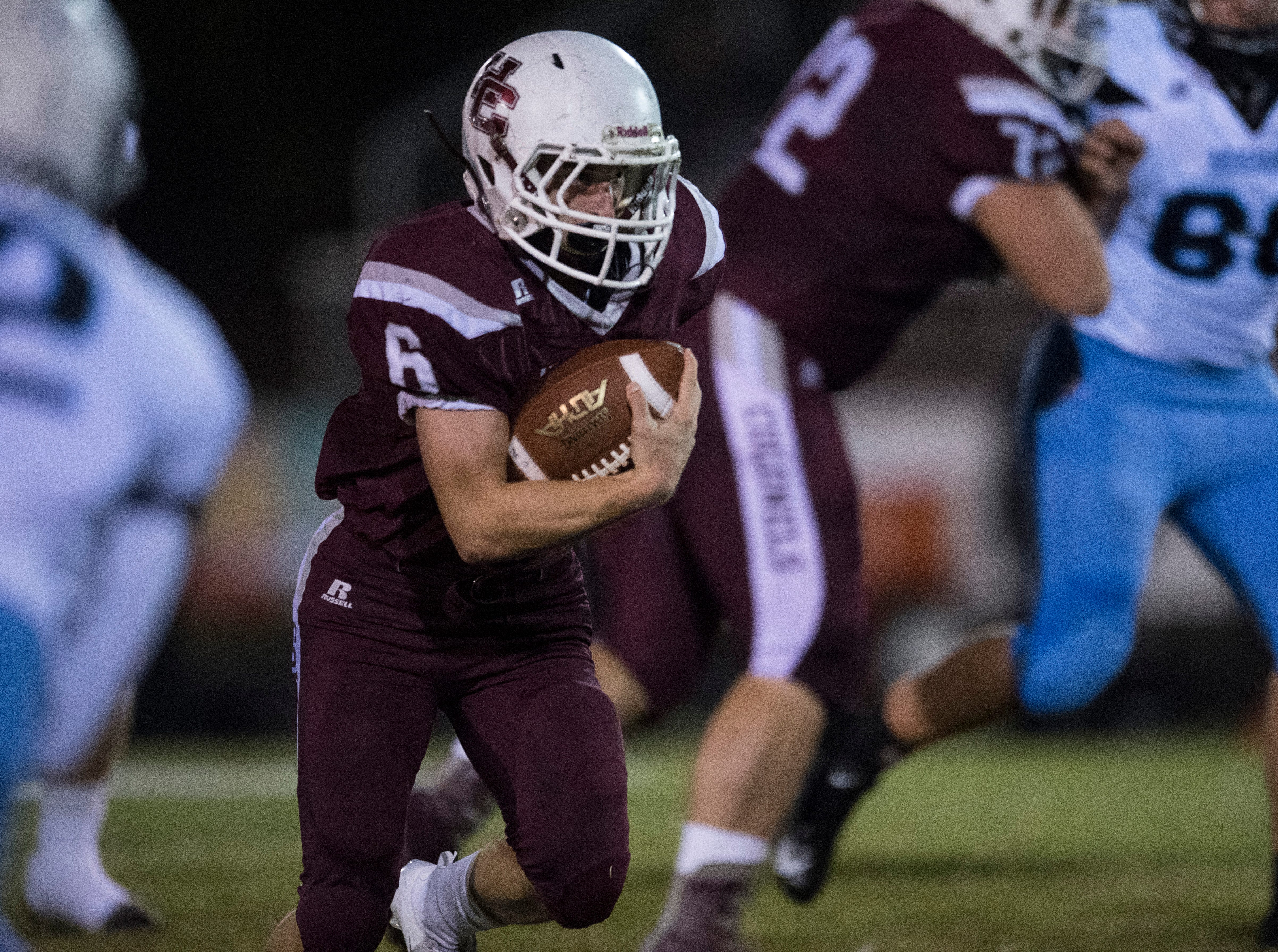 Henderson's Logan Green (6) carries the ball during the Henderson vs Muhlenberg County game at Colonel Stadium Friday, Sept. 28, 2018. The Henderson County Colonels won, 61-6.
