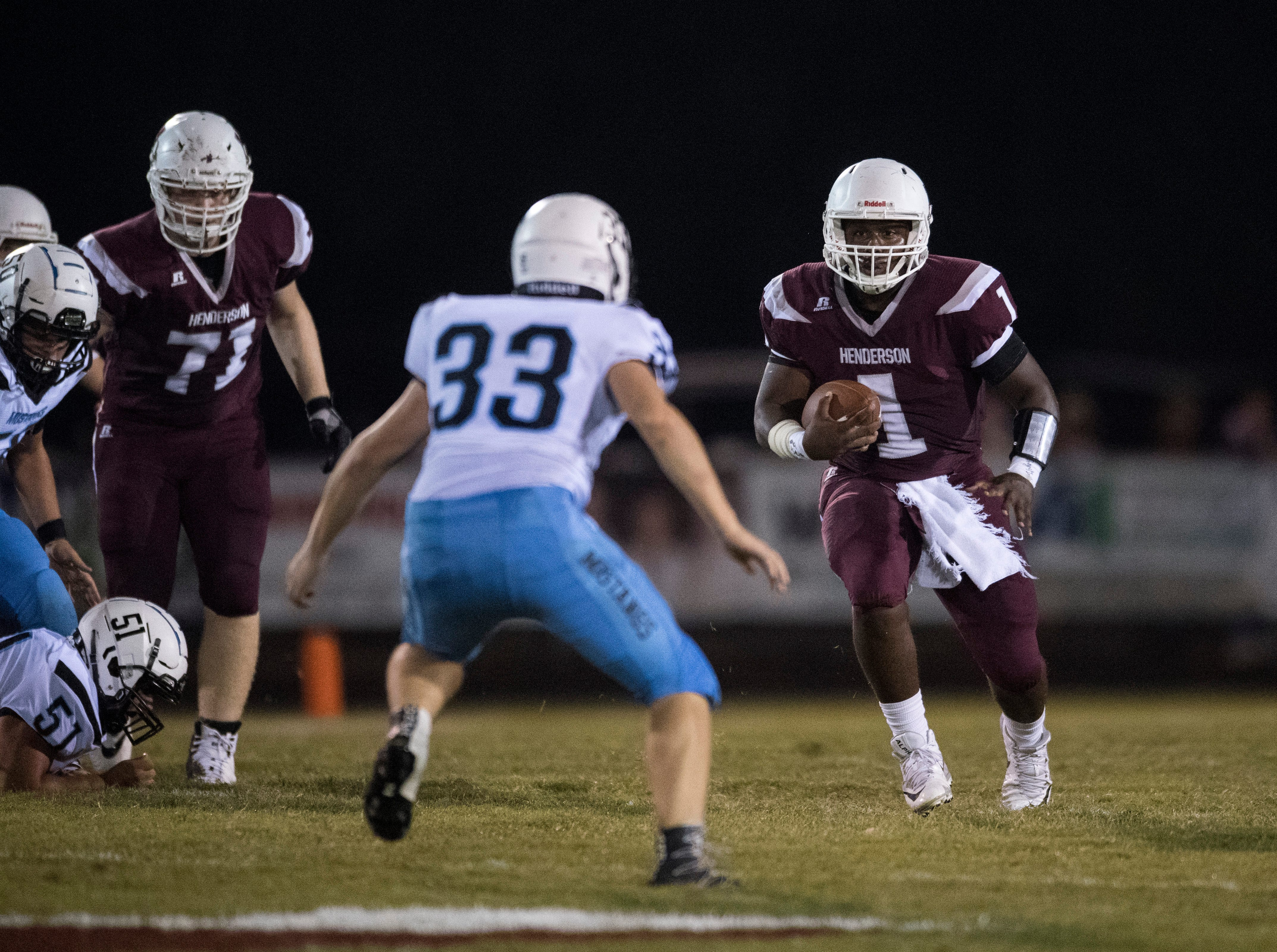 Henderson's Quarterback Skip Patterson (1) carries the ball during the Henderson vs Muhlenberg County game at Colonel Stadium Friday, Sept. 28, 2018. The Henderson County Colonels won, 61-6.
