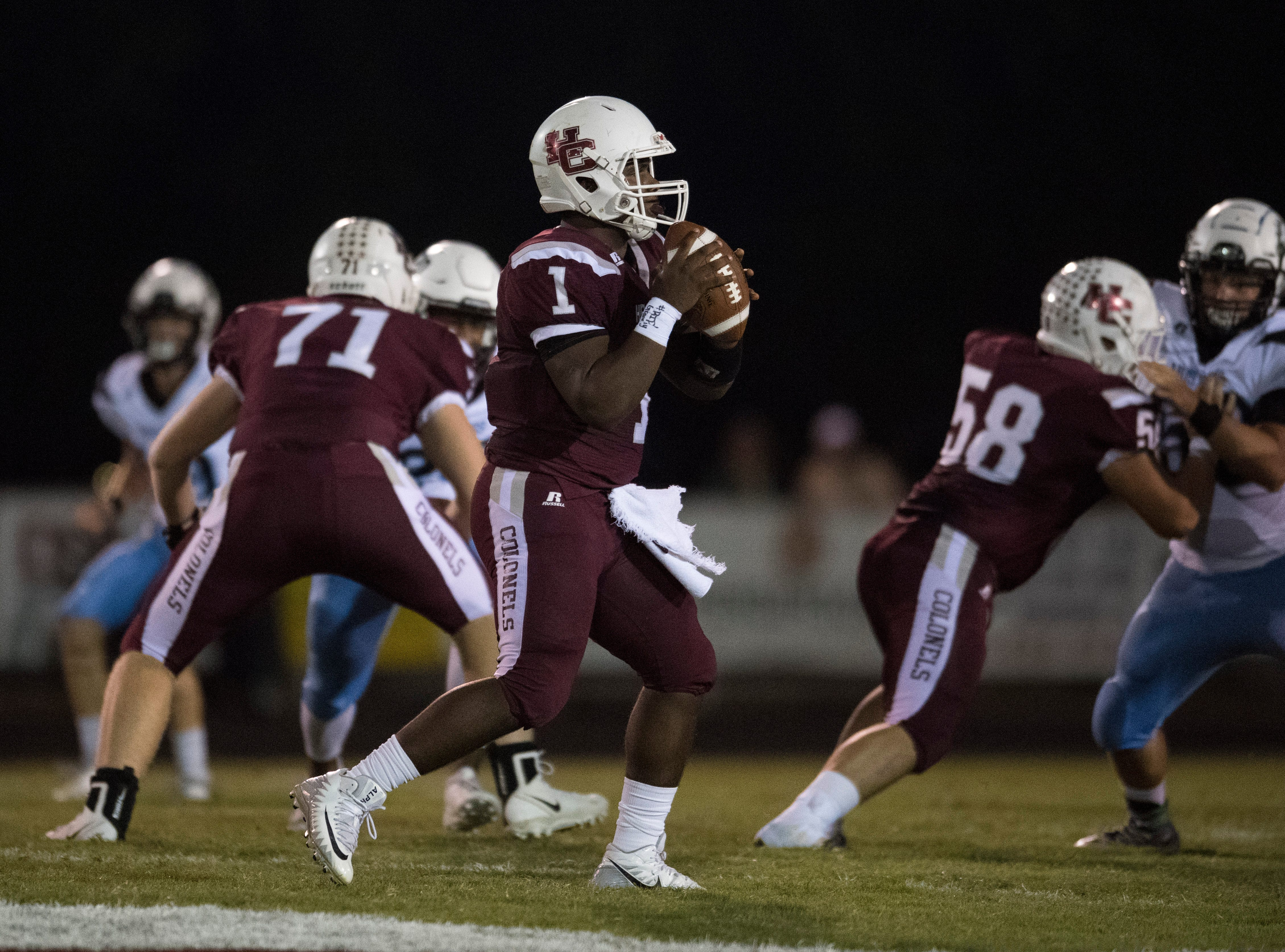 Henderson's Quarterback Skip Patterson (1) looks for an open receiver during the Henderson vs Muhlenberg County game Friday, Sept. 28, 2018. The Henderson County Colonels won, 61-6.