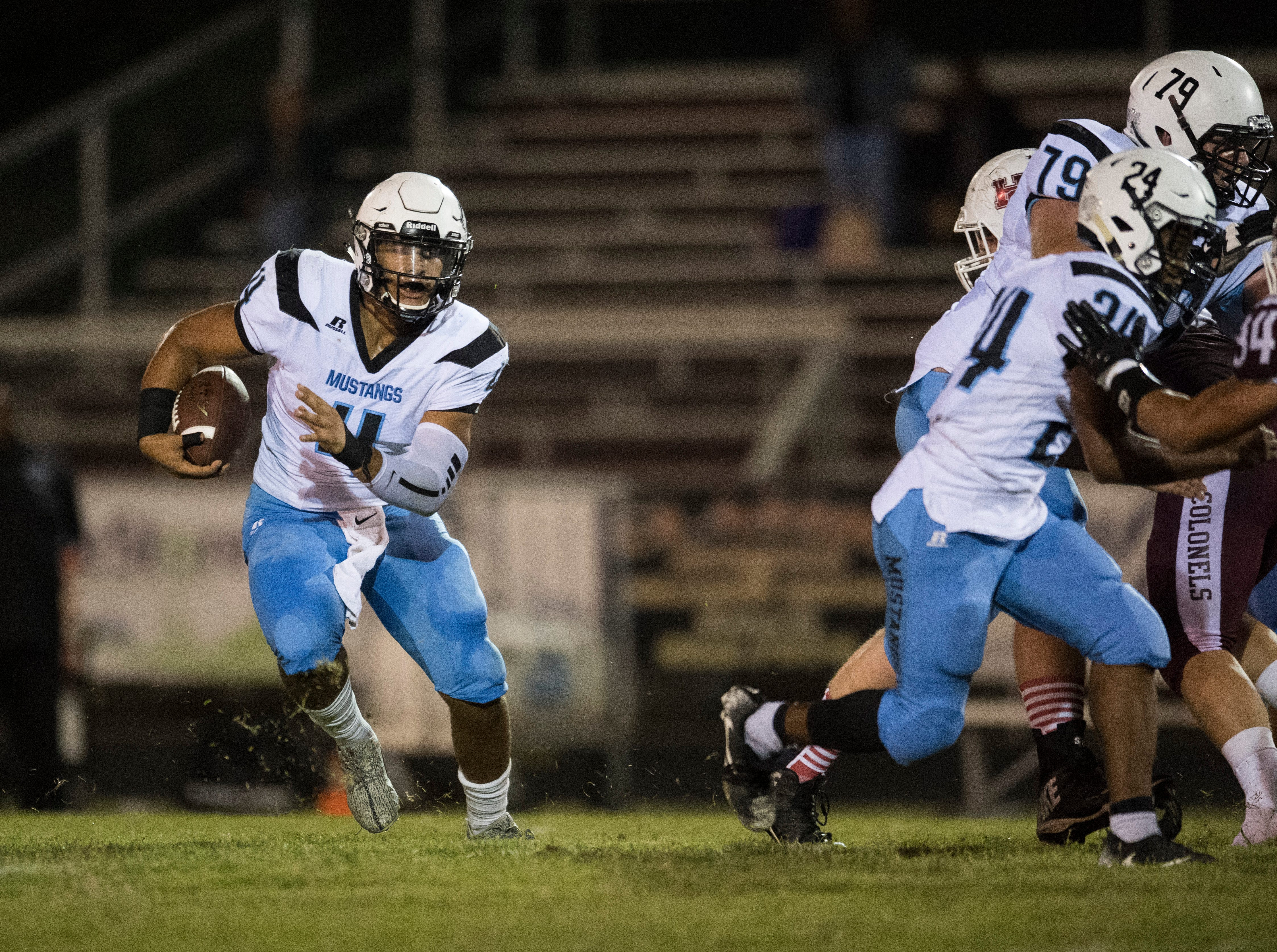 Muhlenberg County's Bronzyn Healy (4) carries the ball during the Henderson vs Muhlenberg County game at Colonel Stadium Friday, Sept. 28, 2018. The Henderson County Colonels won, 61-6.
