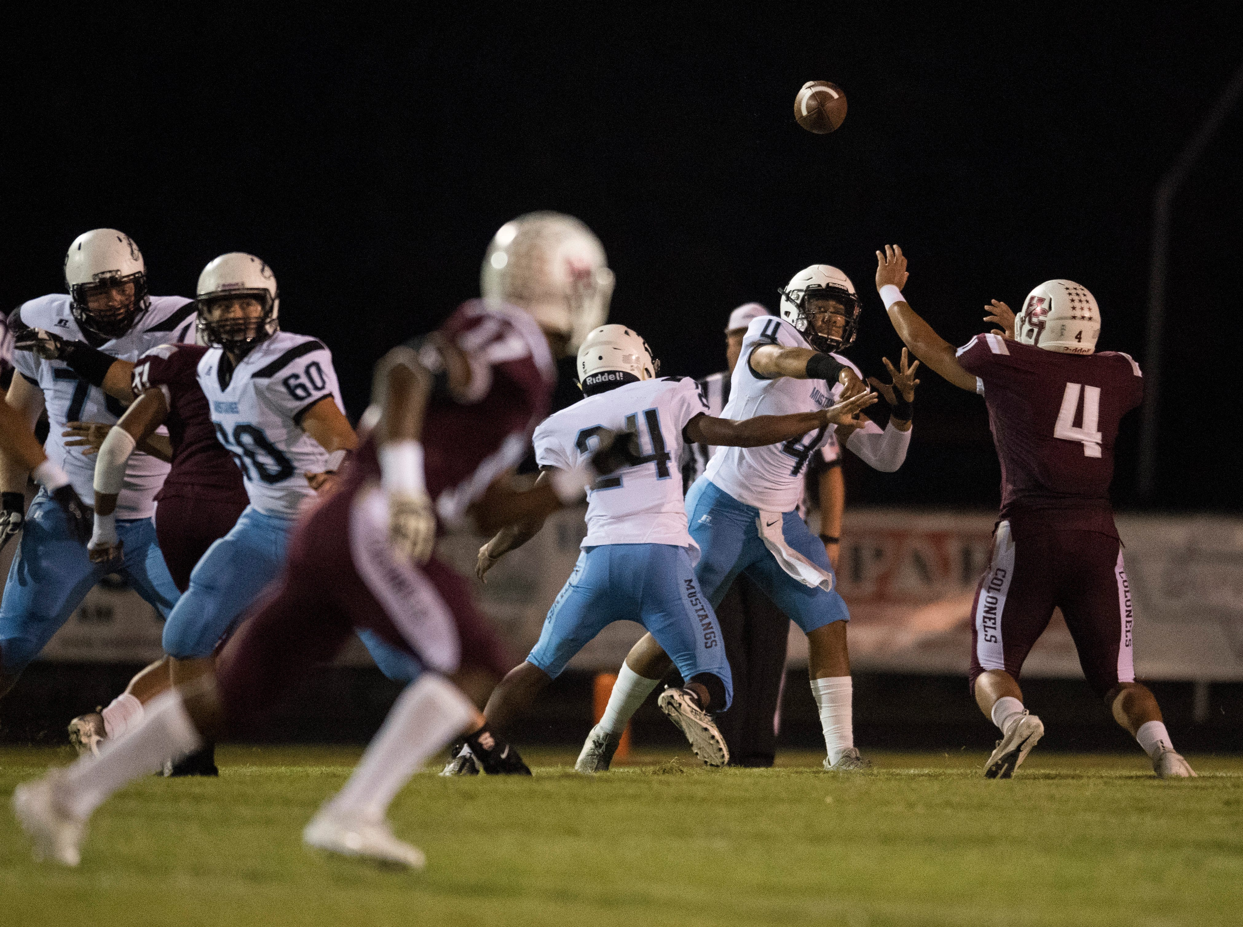 Muhlenberg County's Bronzyn Healy (4) makes a pass during the Henderson vs Muhlenberg County game Friday, Sept. 28, 2018. The Henderson County Colonels won, 61-6.