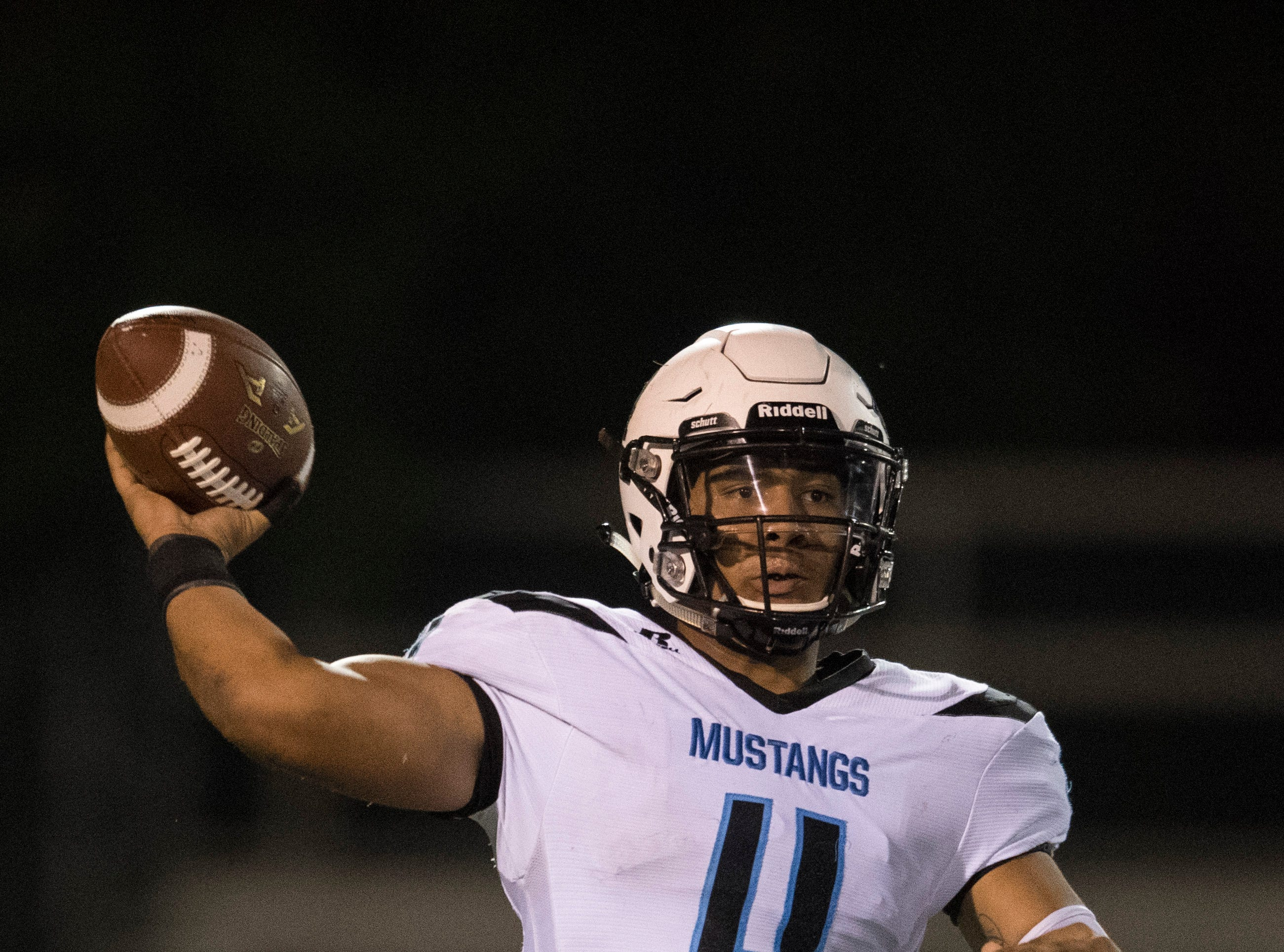 Muhlenberg County's Bronzyn Healy (4) passes the ball during the Henderson vs Muhlenberg County game at Colonel Stadium Friday, Sept. 28, 2018. The Henderson County Colonels won, 61-6.