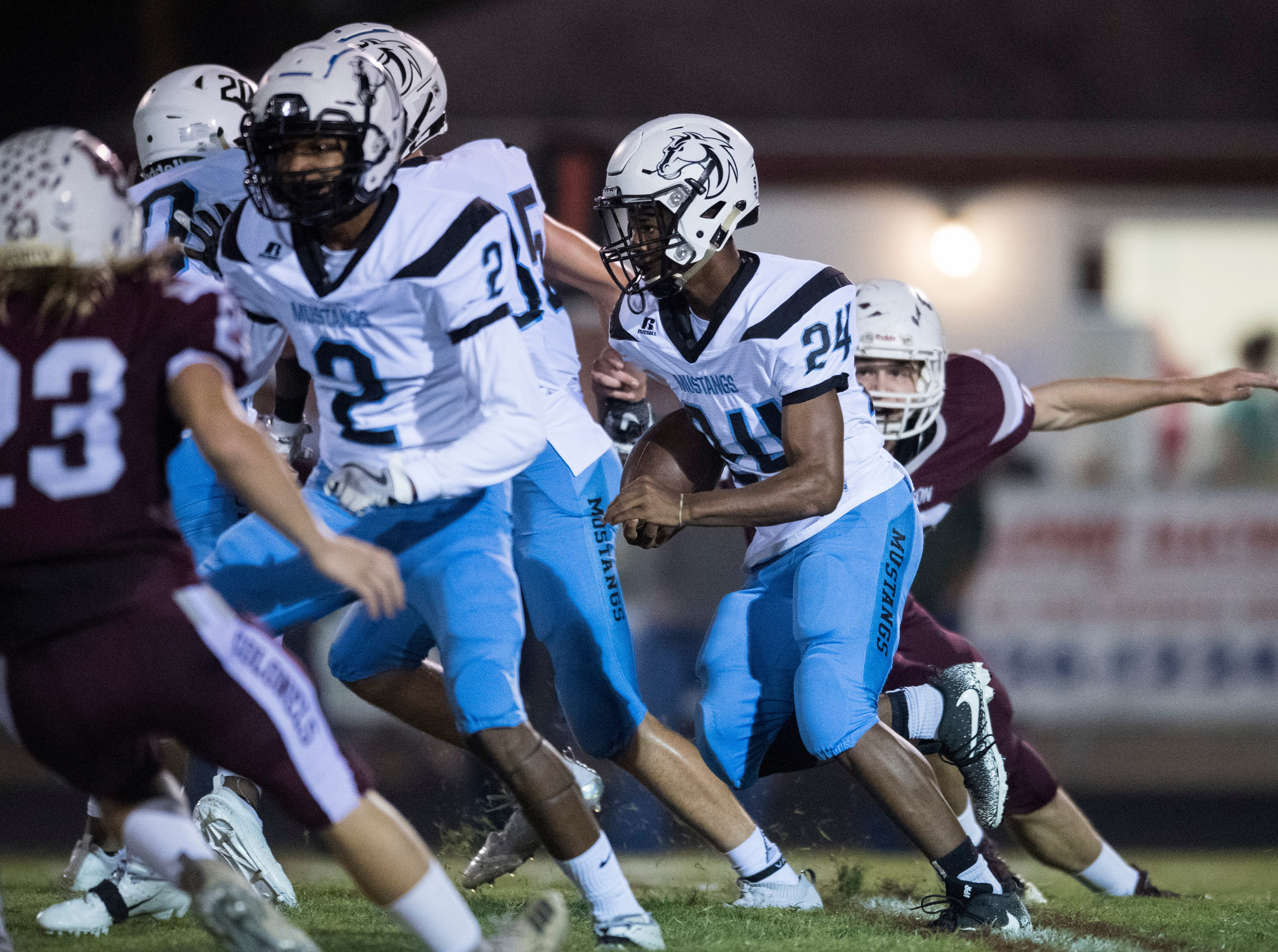 Muhlenberg County's Winky Drake (24) carries the ball during the Henderson vs Muhlenberg County game Friday, Sept. 28, 2018. The Henderson County Colonels won, 61-6.