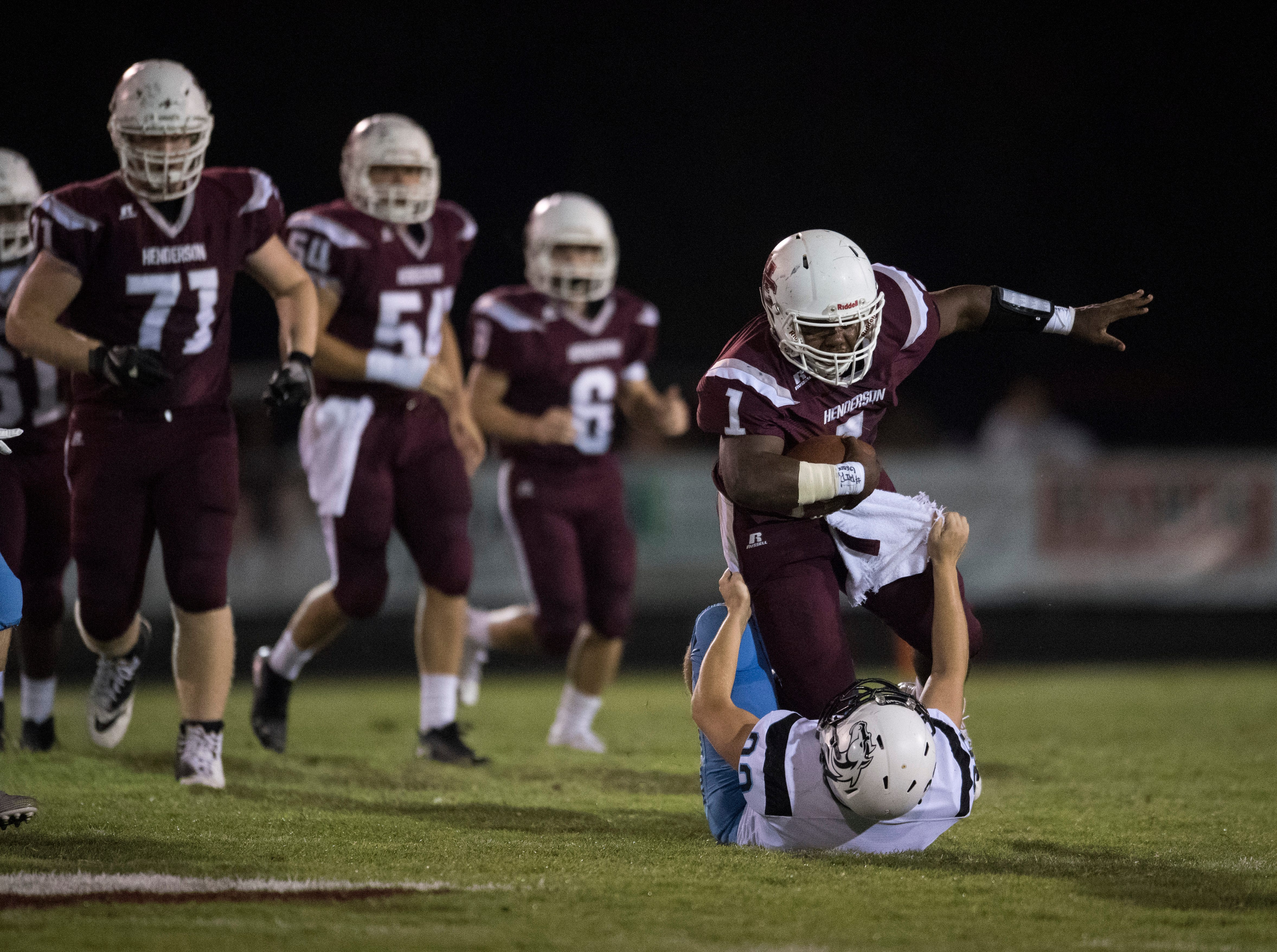 Henderson's Quarterback Skip Patterson (1) runs over Mustang defense during the Henderson vs Muhlenberg County game Friday, Sept. 28, 2018. The Henderson County Colonels won, 61-6.