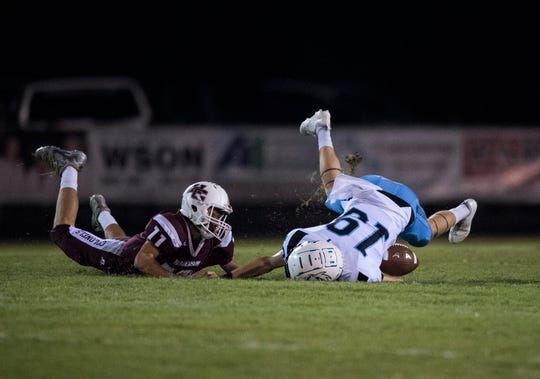 Henderson's Garrett Greenwell (11) tackles Muhlenberg County's Chris Chaney (19) during the Henderson vs Muhlenberg County game at Colonel Stadium Friday, Sept. 28, 2018. The Henderson County Colonels won, 61-6.