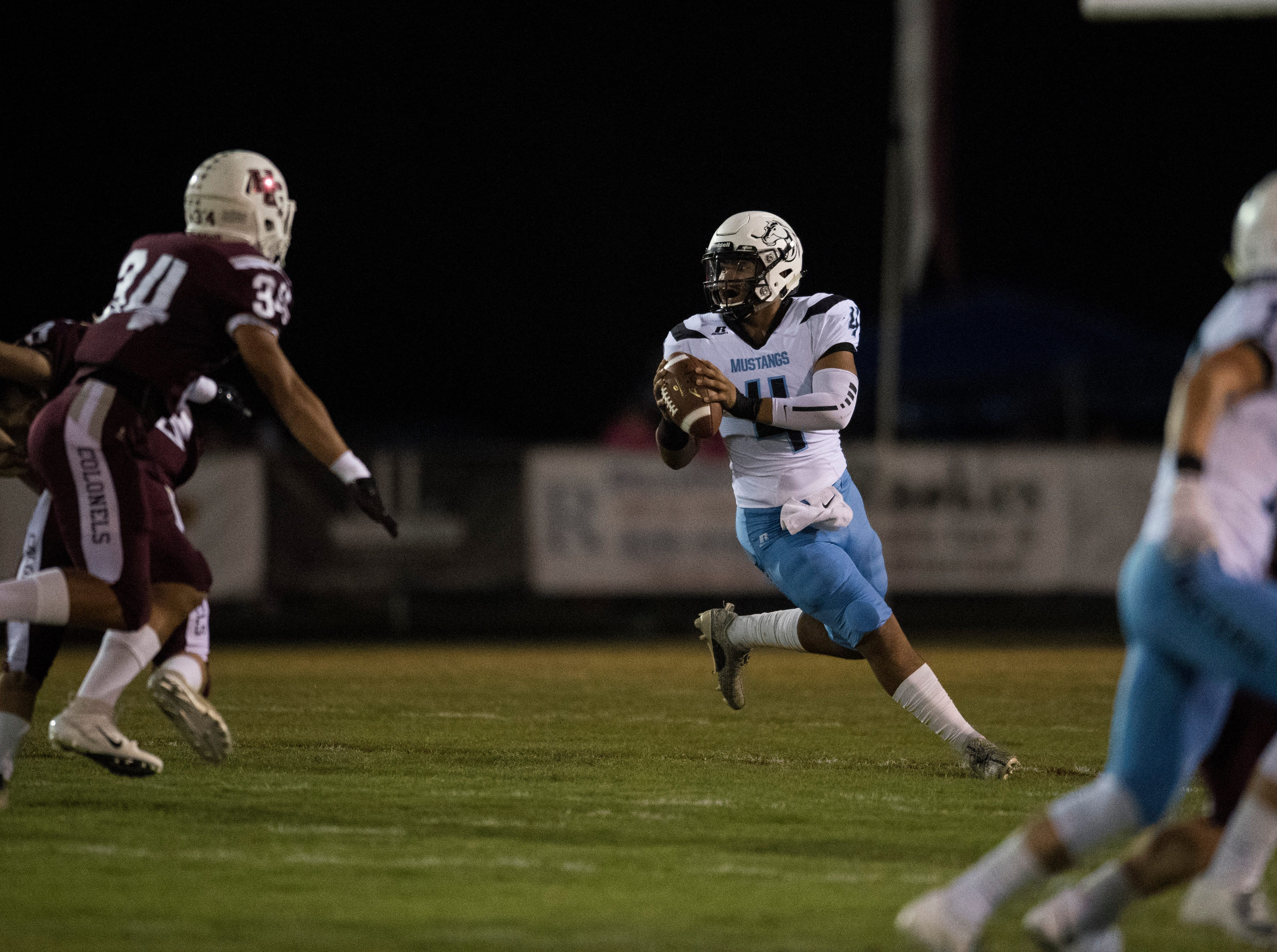 Muhlenberg County's Bronzyn Healy (4) looks for an open receiver during the Henderson vs Muhlenberg County game at Colonel Stadium Friday, Sept. 28, 2018. The Henderson County Colonels won, 61-6.