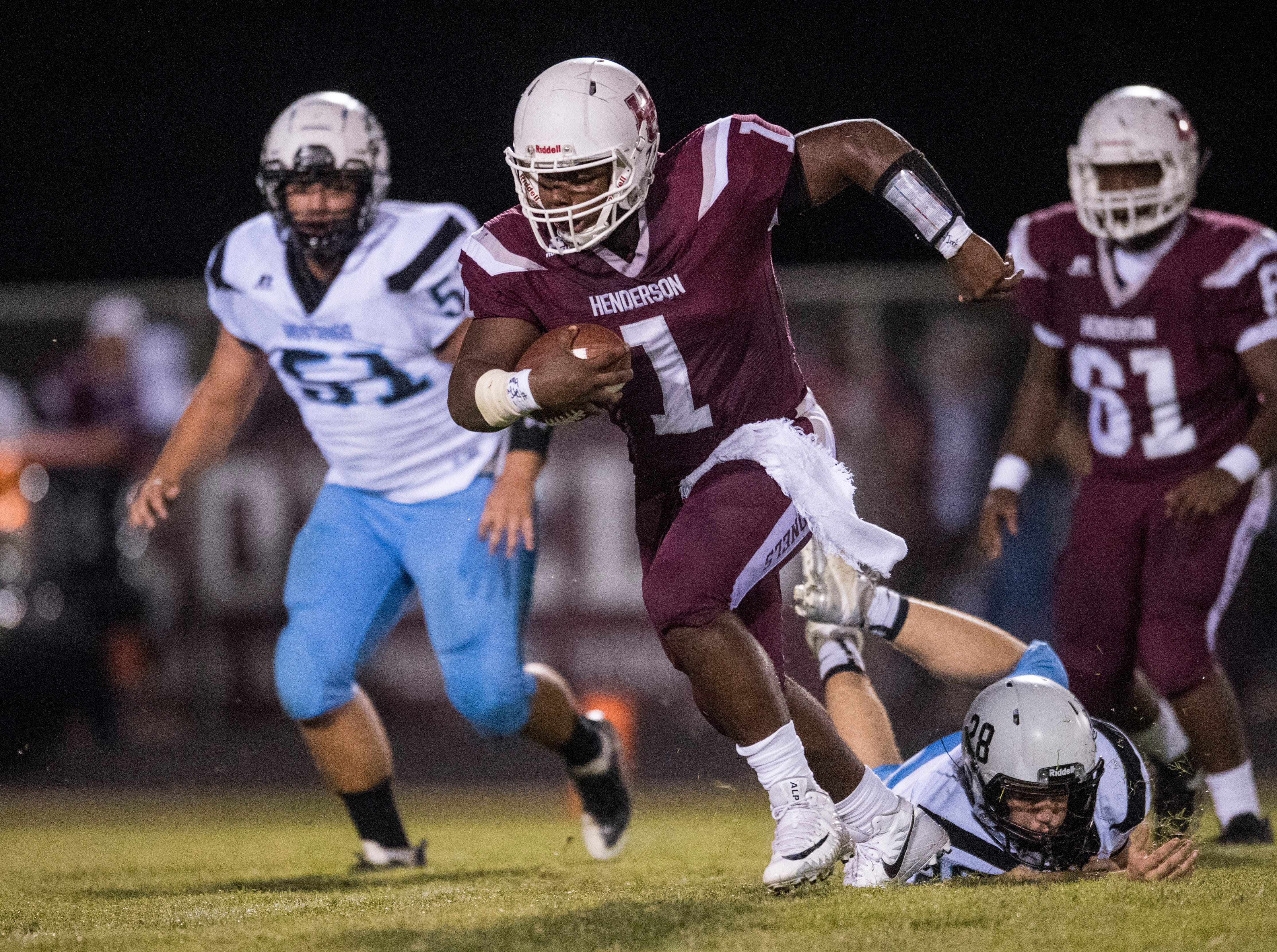 Henderson's Quarterback Skip Patterson (1) carries the ball during the Henderson vs Muhlenberg County game Friday, Sept. 28, 2018. The Henderson County Colonels won, 61-6.
