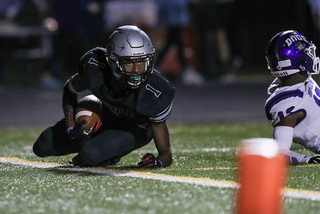 Zionsville Eagles wide receiver Jordan Hull (1) looks up to the referee after landing in the end zone for a touchdown during the first half of the game against Brownsburg at Zionsville High School in Zionsville, Ind., Friday, Sept. 28, 2018. Brownsburg won, 70-52.