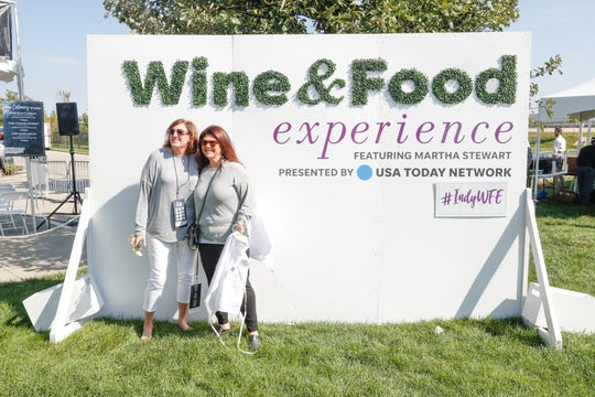 Suzanne Dagley, left, and Stacey Alm, right, poses for a selfie during the IndyStar Wine & Food Experience, held at Clay Terrace Mall in Carmel Ind., on Saturday, Sept. 29, 2018.