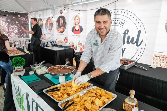 Adrian Arechiga with Verde Flavors of Mexico Catering serves up chips and salsa during the IndyStar Food and Wine Experience, held at Clay Terrace Mall in Carmel Ind., on Saturday, Sept. 29, 2018.