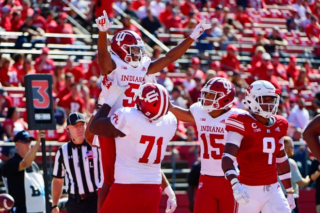 J-Shun Harris II #5 of the Indiana Hoosiers is hoisted by teammate Delroy Baker #71 after scoring a touchdown against the Rutgers Scarlet Knights during the second quarter at HighPoint.com Stadium on September 29, 2018 in Piscataway, New Jersey.
