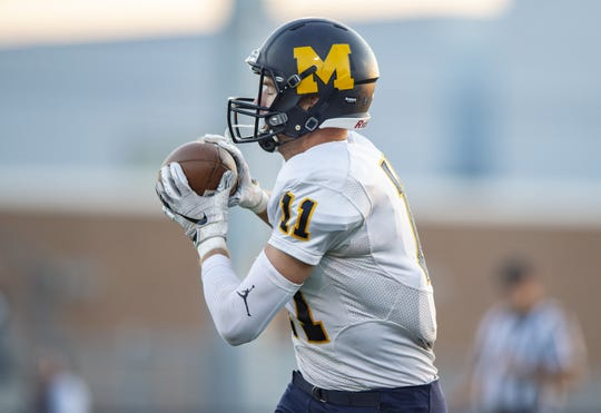 Mooresville High School senior Jon Eineman (11) pulls in a pass reception during the first half of action. Whiteland hosted Mooresville in IHSAA varsity football action, Friday, Sept. 28, 2018.