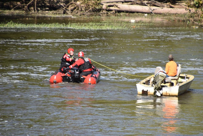 Indianapolis firefighters rescued an Indianapolis man and his dog when they became stranded on the White River on Friday, Sept. 28, 2018.