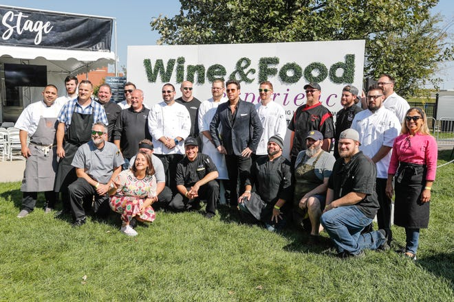 Chefs pose for a photo during the IndyStar Wine & Food Experience, held at Clay Terrace Mall in Carmel Ind., on Saturday, Sept. 29, 2018.